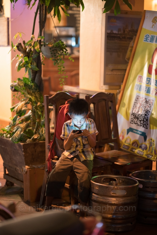 Child and Screen downtown Siem Reap Cambodia