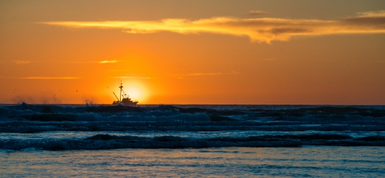 cannon beach fishing boat sunset