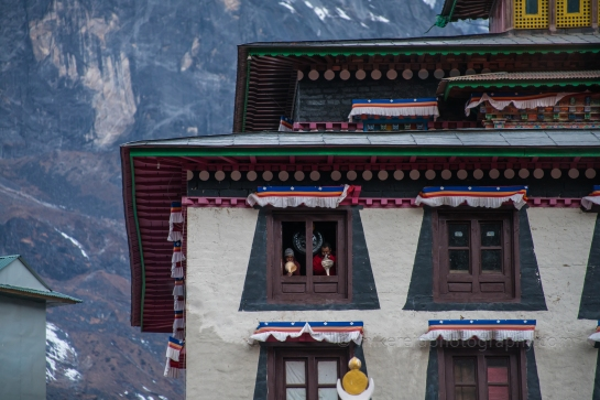Monks blowing a conch shell to welcome the morning in Tengboche
